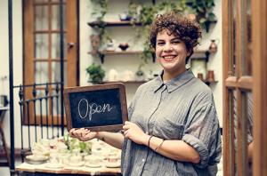 shop insurance woman happy owner shopowner retail insurance insuremyshop